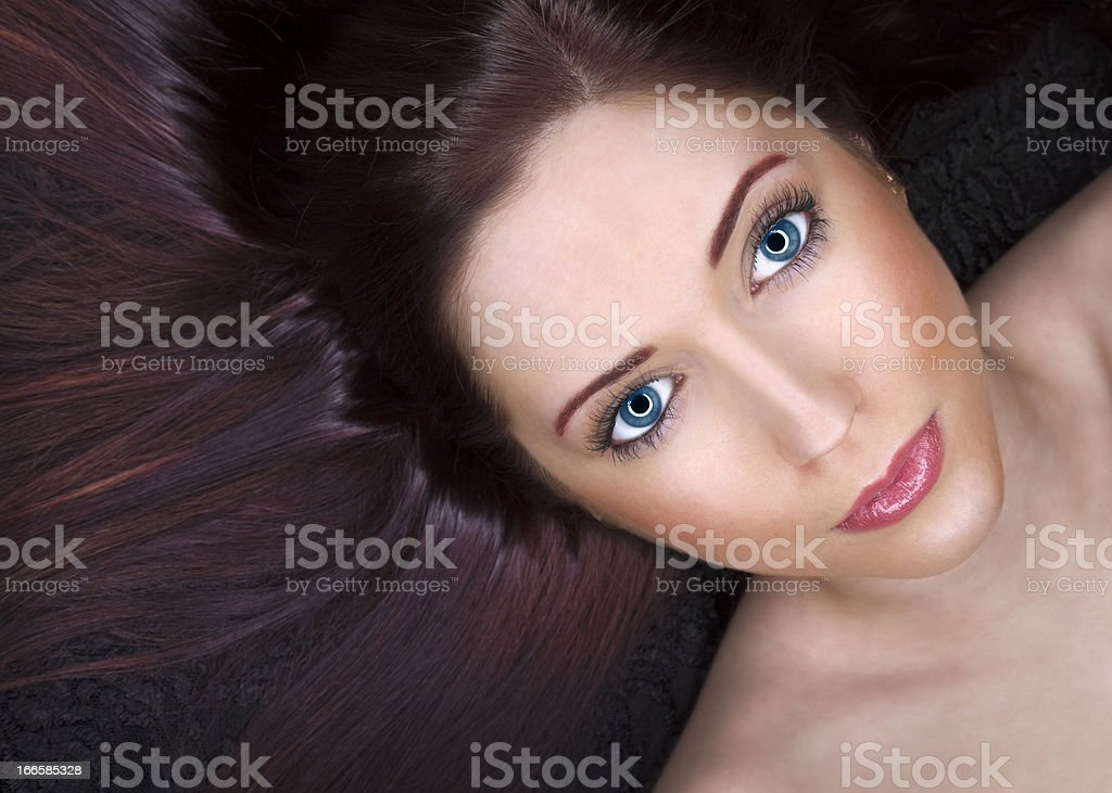 Beautiful Woman With Amazing Eyes and Perfect Silky Hair royalty-free stock photo