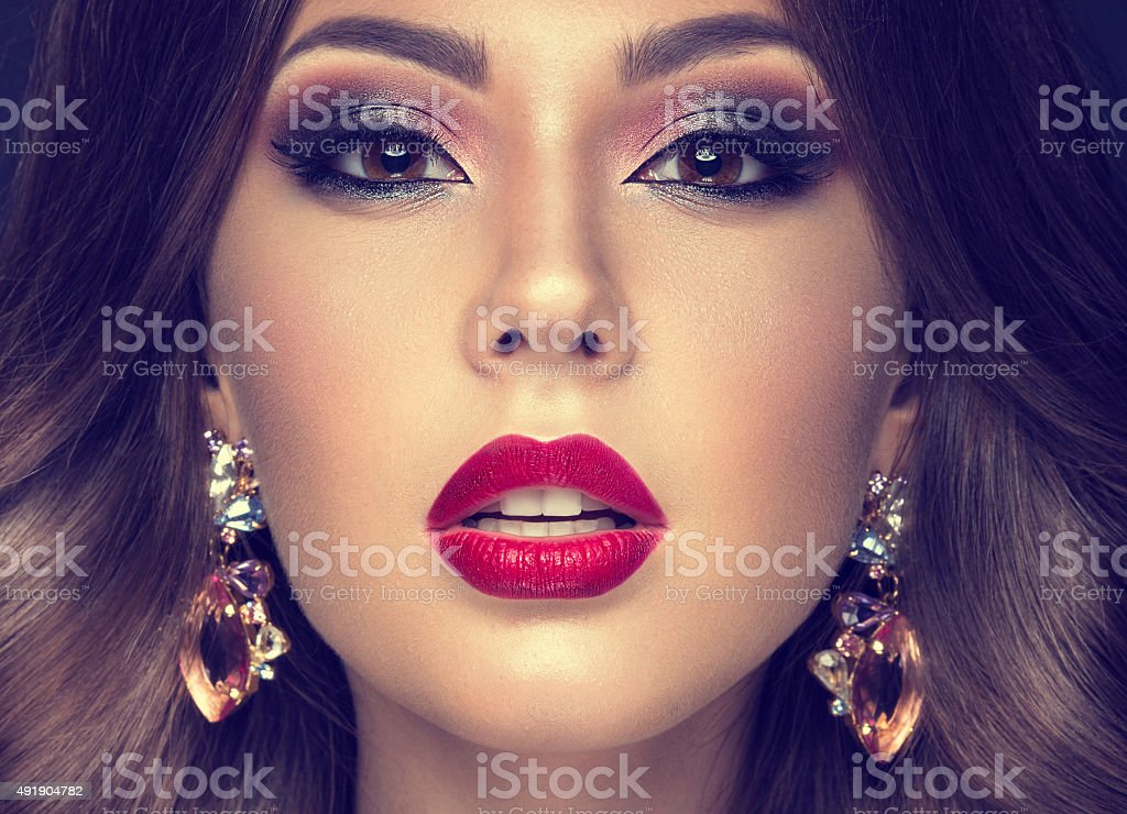 Beautiful woman with arabic make-up, red lips and curls. Beauty face....