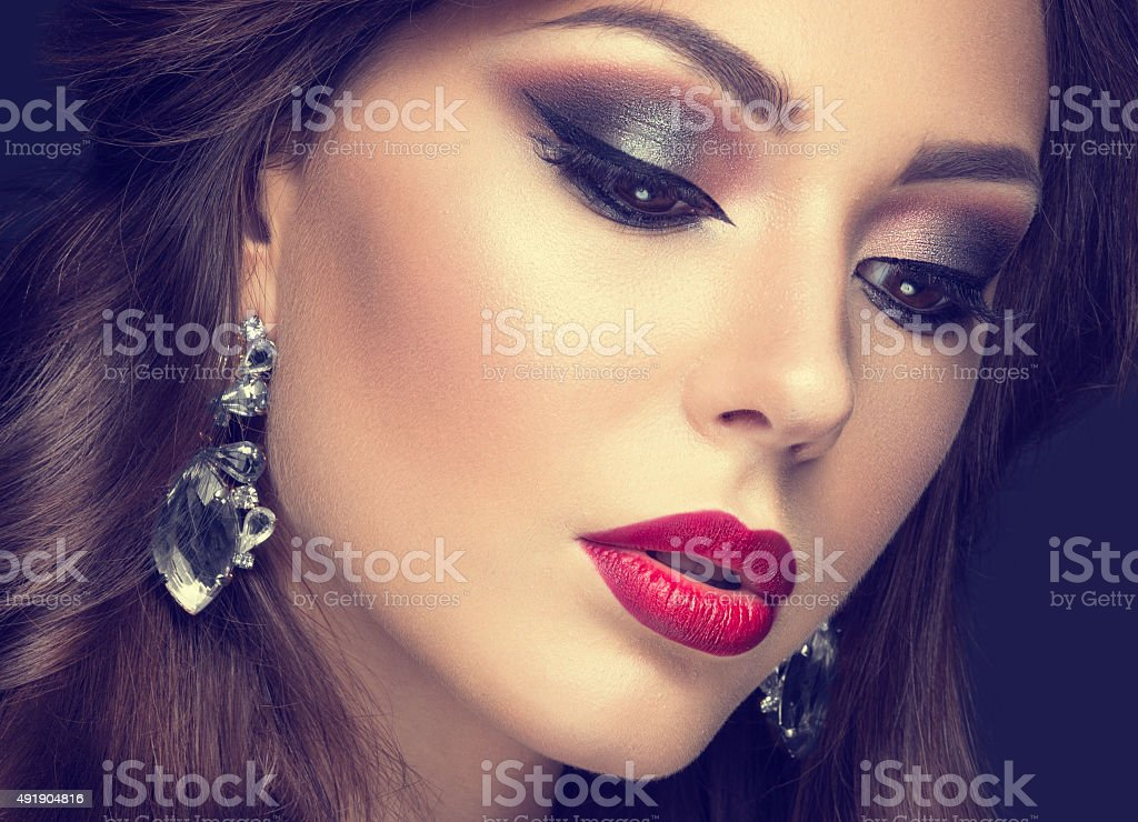 Beautiful woman with arabic make-up, red lips and curls stock photo
