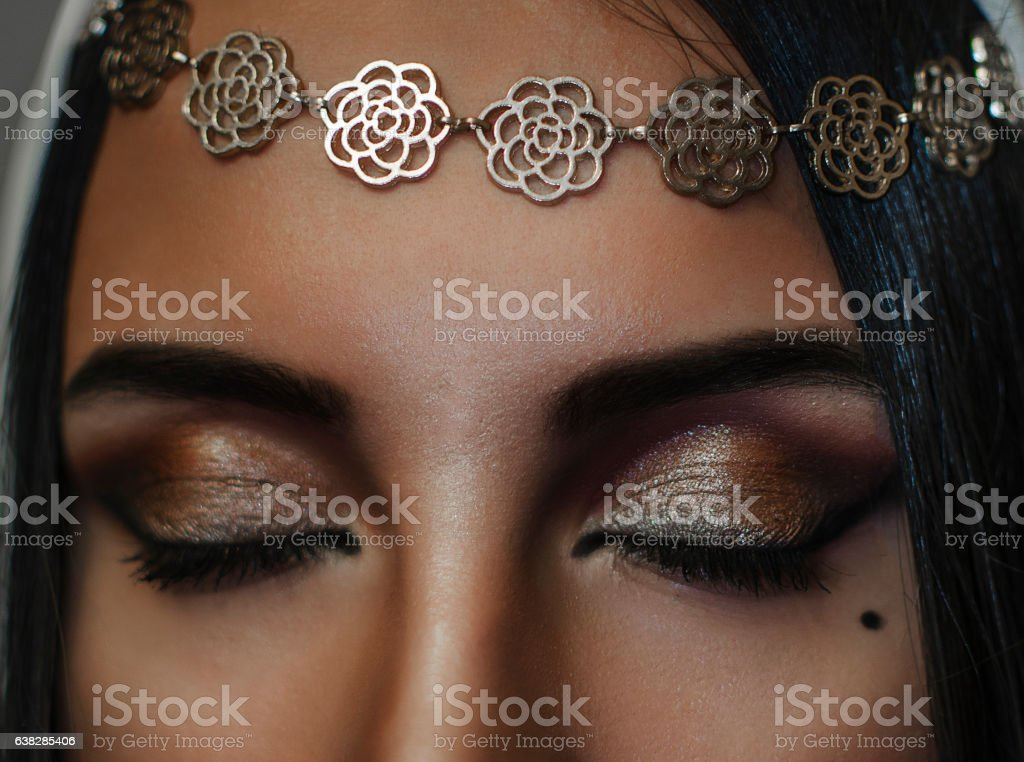 Beautiful woman with arabic make-up, red lips and curls. stock photo