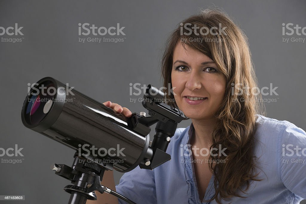 Beautiful woman with astronomical telescope royalty-free stock photo