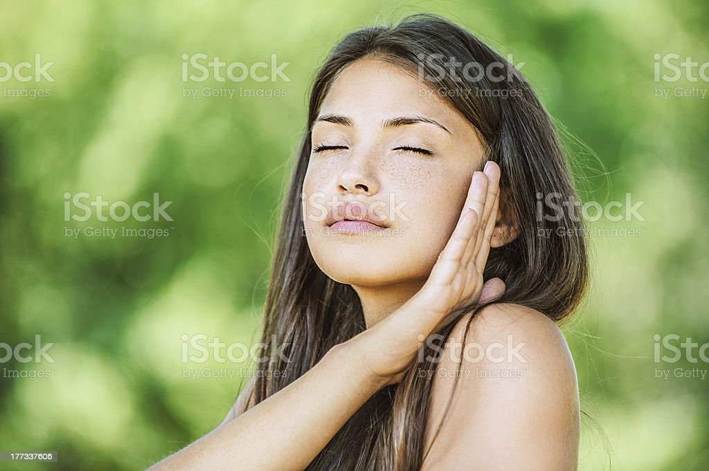 beautiful woman with bare shoulders and eyes closed stock photo