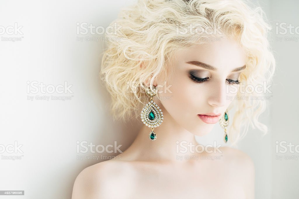 Beautiful woman with beautiful earings and hairstyle stock photo
