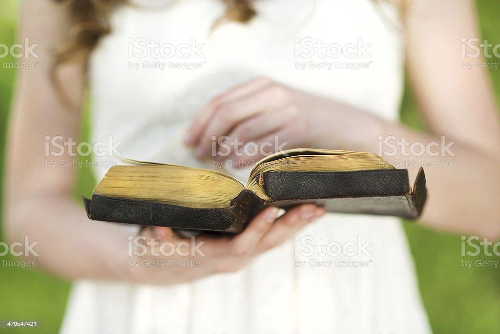 Beautiful woman with Bible stock photo