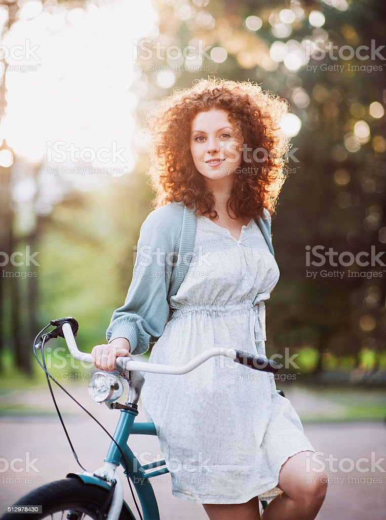 Beautiful woman with bike stock photo