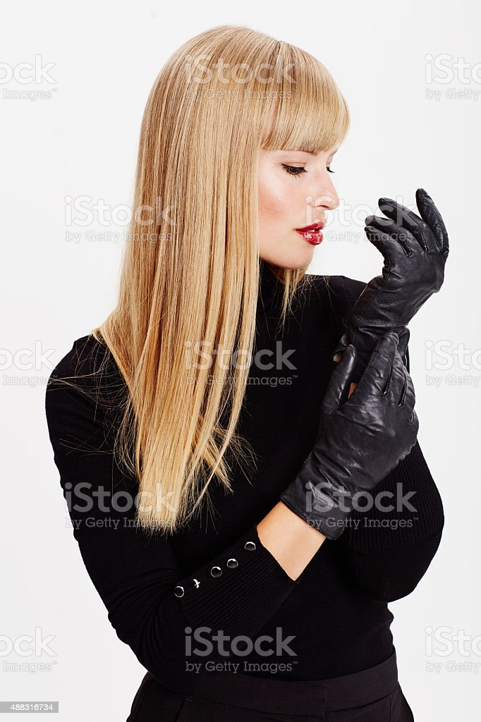 Beautiful woman with black gloves stock photo