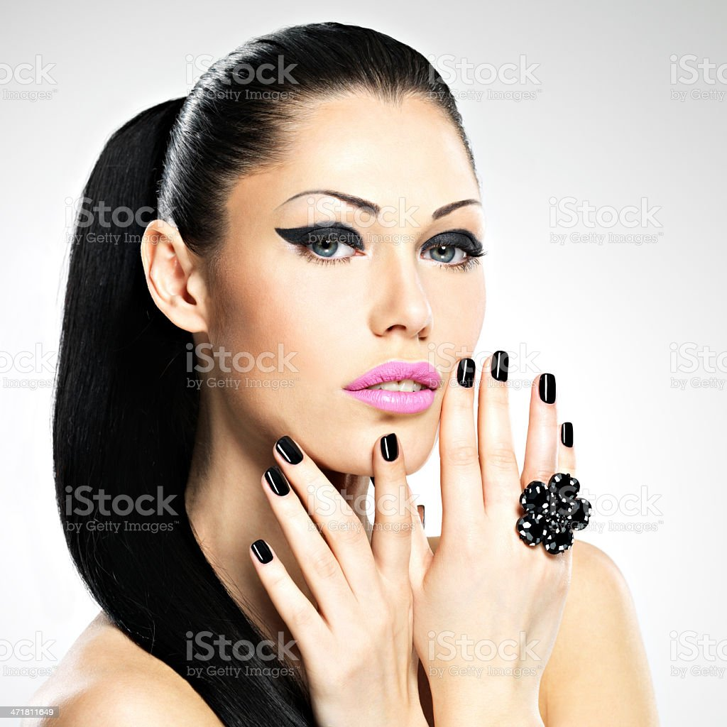 Beautiful woman with black nails and pink lips royalty-free stock photo