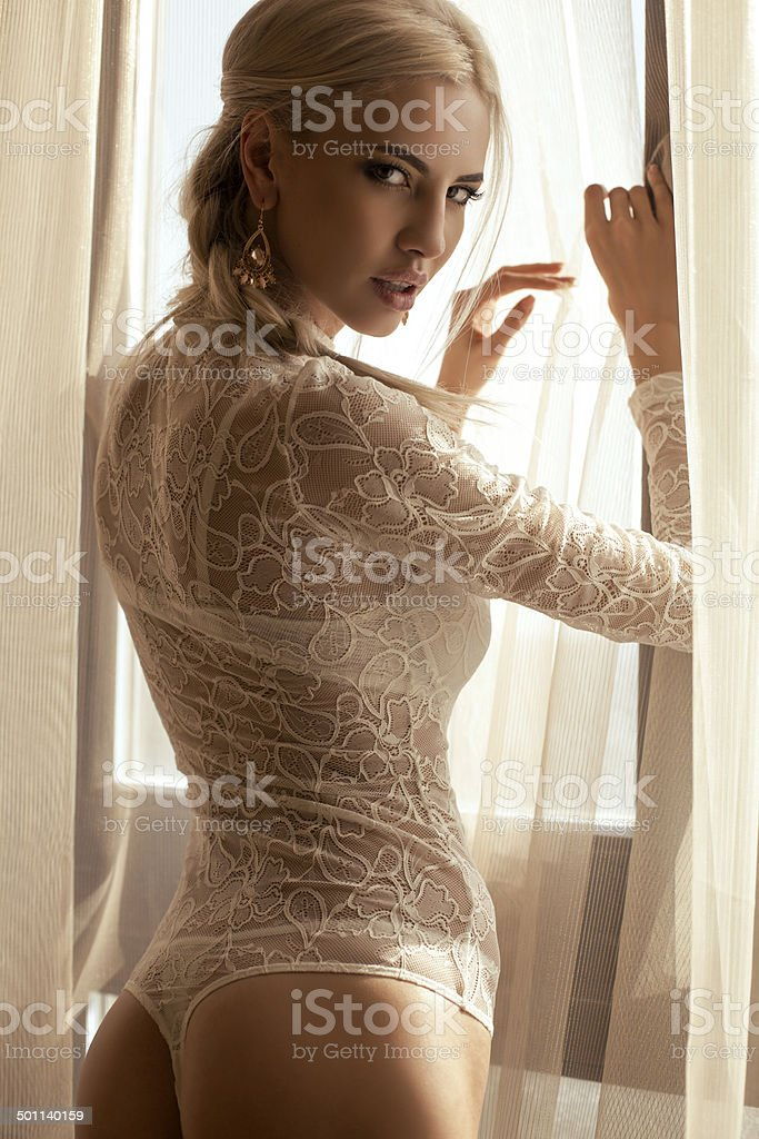 Beautiful woman with blond hair in lace lingerie stock photo