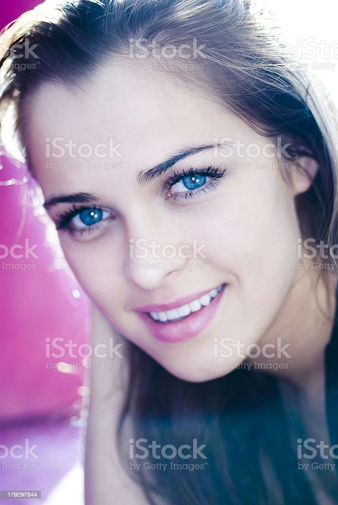 Beautiful woman with blue eyes smiling stock photo