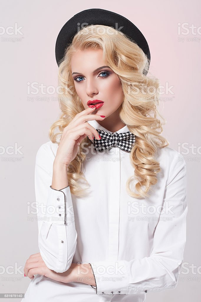Beautiful Woman with bow-tie in the hat stock photo