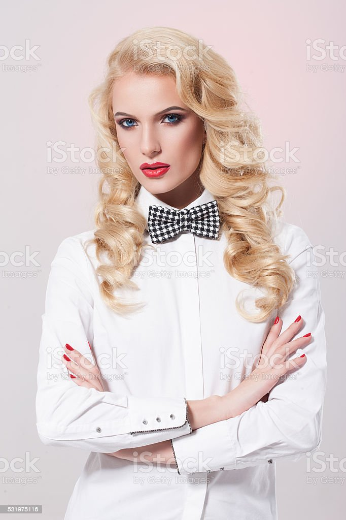 Beautiful Woman with bow-tie stock photo