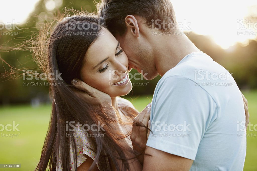 Beautiful woman with boyfriend in park royalty-free stock photo
