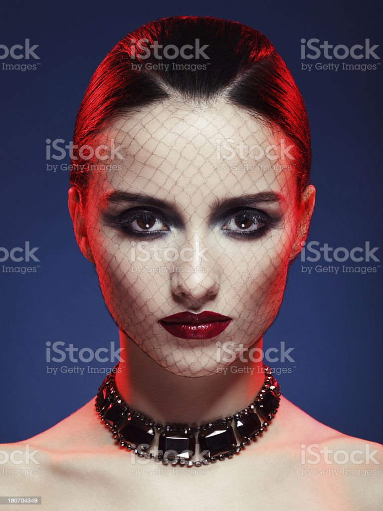 Beautiful woman with bright make-up and necklace royalty-free stock photo