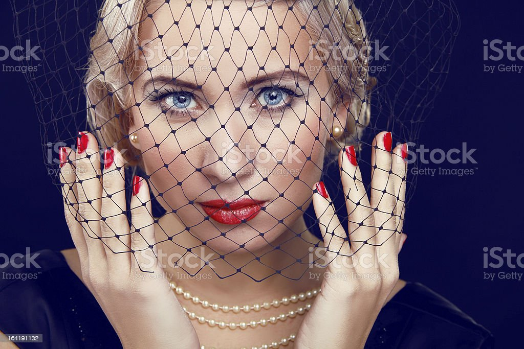 Beautiful woman with bright makeup and red nails. Retro Style royalty-free stock photo