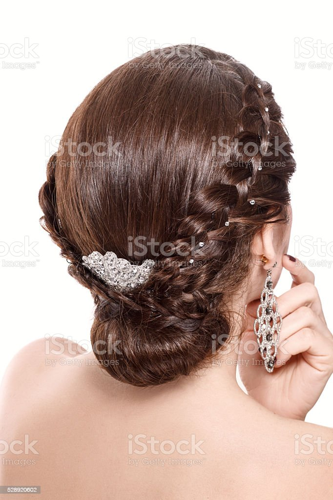 beautiful woman with brunette hair and braid hairdo. Rear view. stock photo