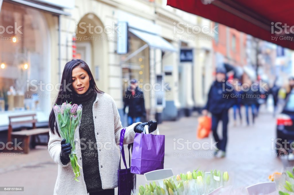 Beautiful woman with bunch of flowers stock photo