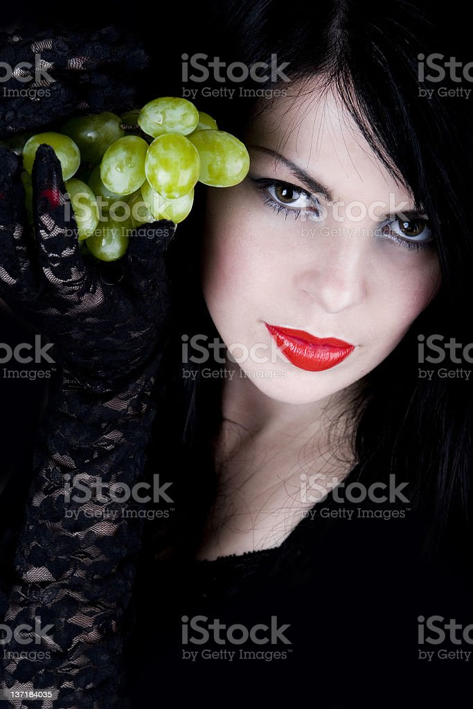 Beautiful woman with bunch of grape royalty-free stock photo
