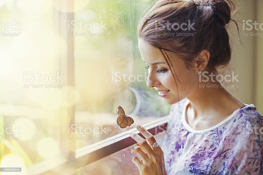 Beautiful woman with butterfly stock photo