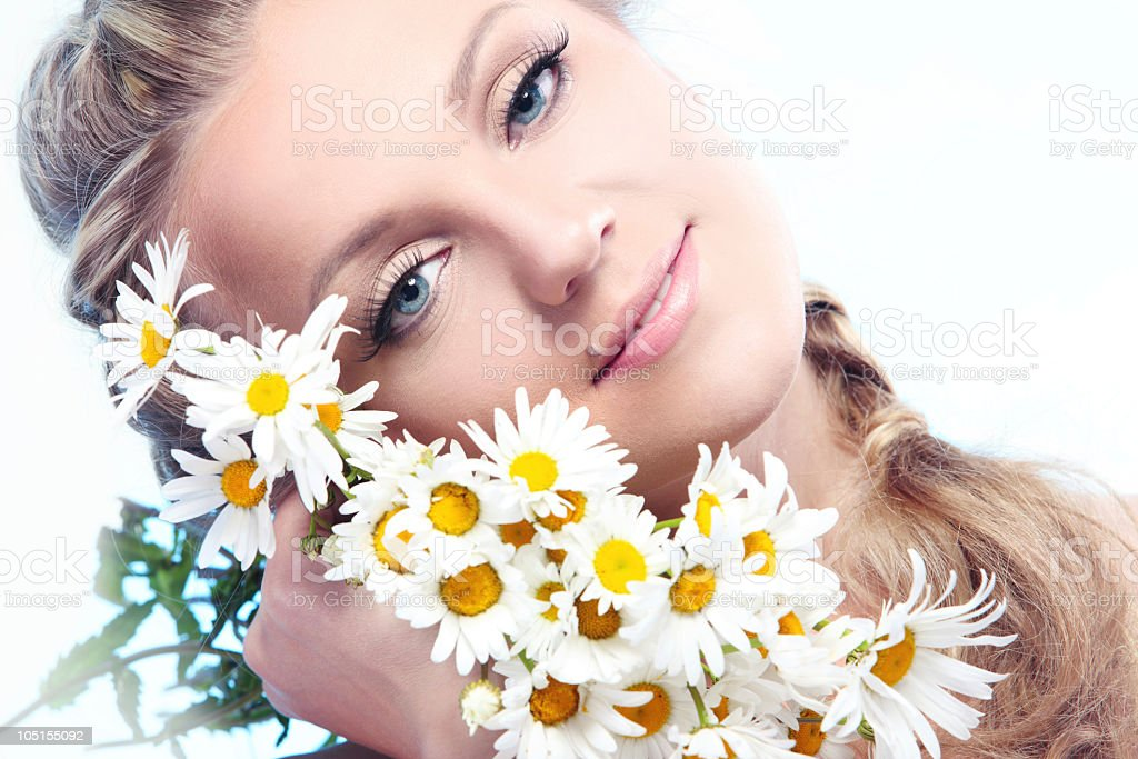 beautiful woman with camomile. royalty-free stock photo