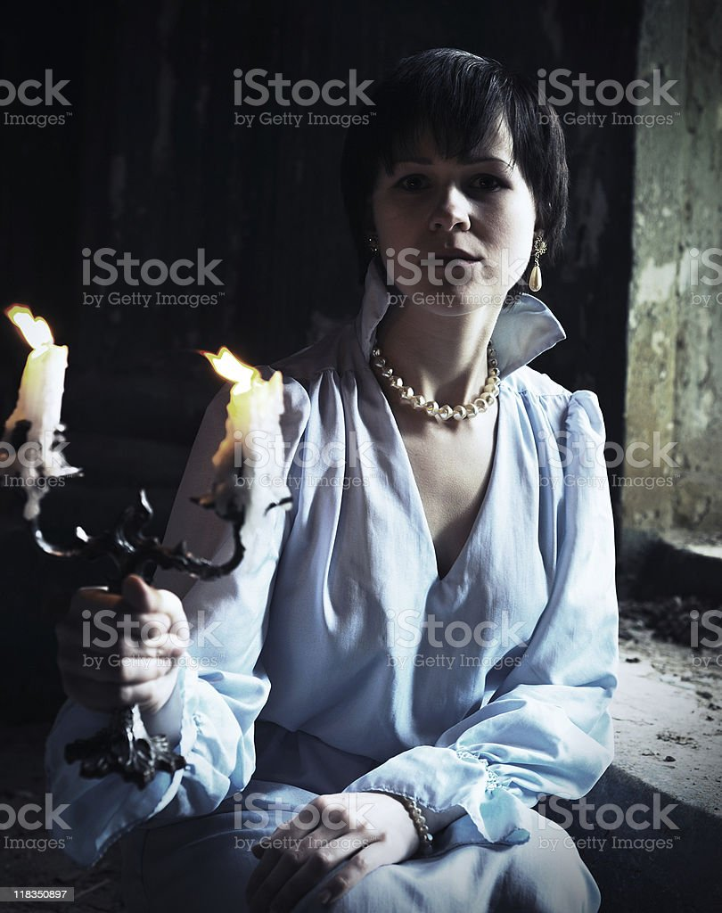 Beautiful woman with candles in retro style royalty-free stock photo