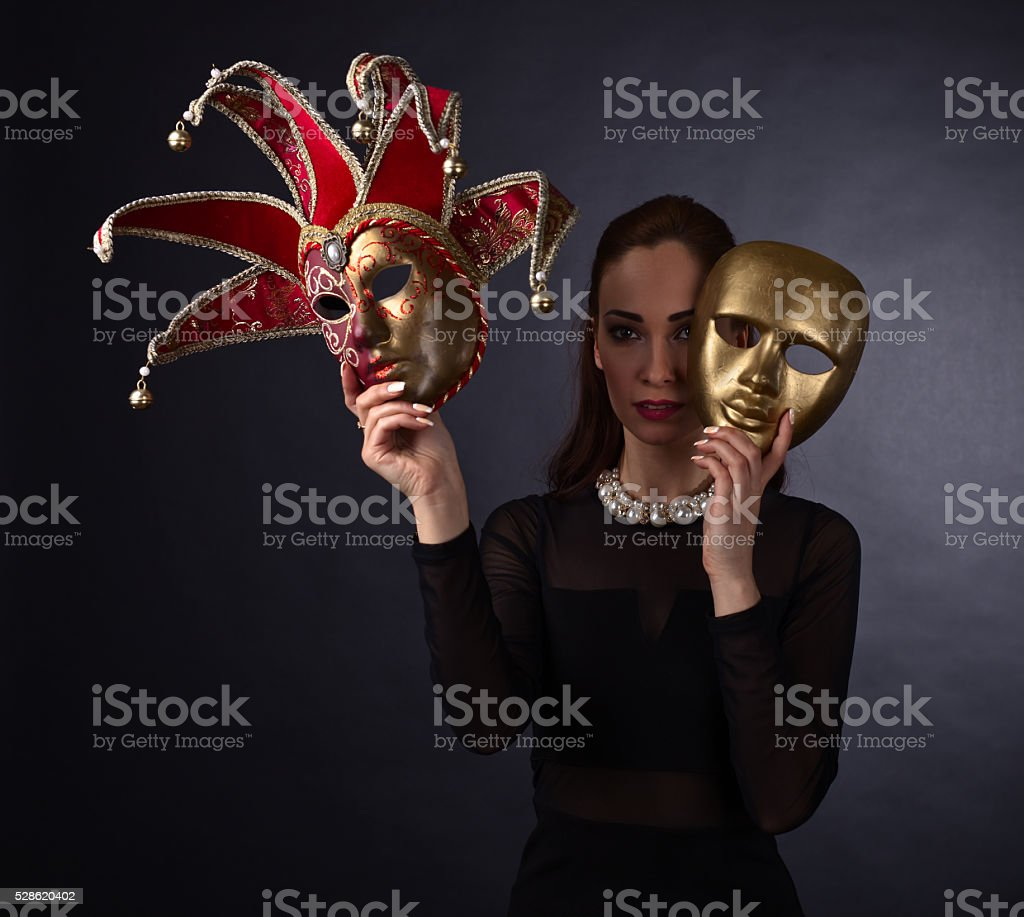 Beautiful woman with carnival mask stock photo