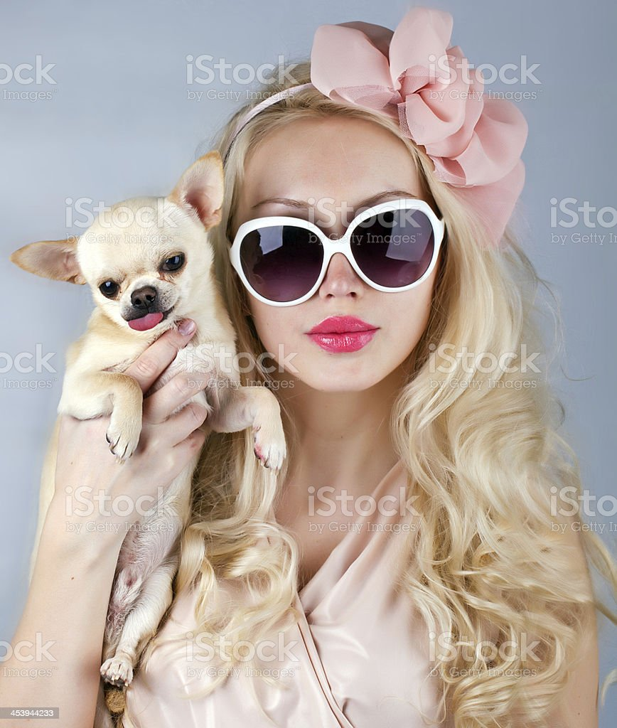 Beautiful woman with chihuahua in hands stock photo