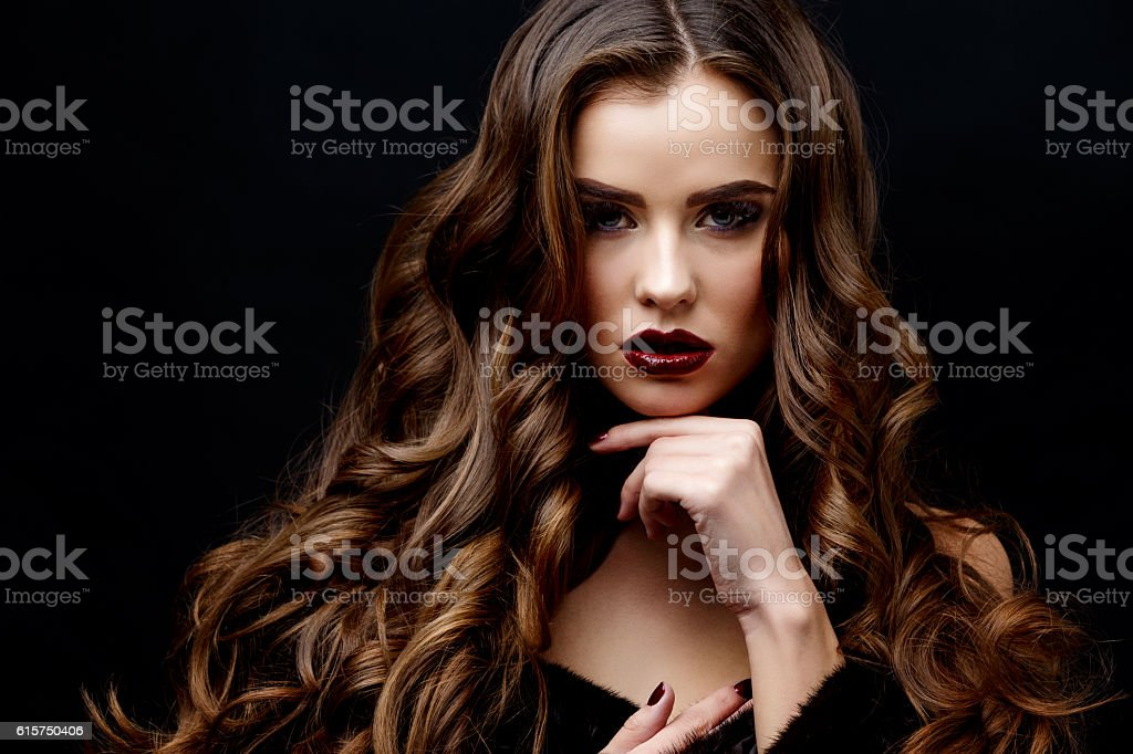 Beautiful Woman with Clean Fresh Skin and healthy curly hair stock photo