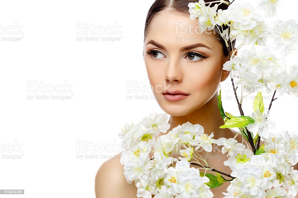 Beautiful Woman with Clean Fresh Skin holding flowering branches stock photo