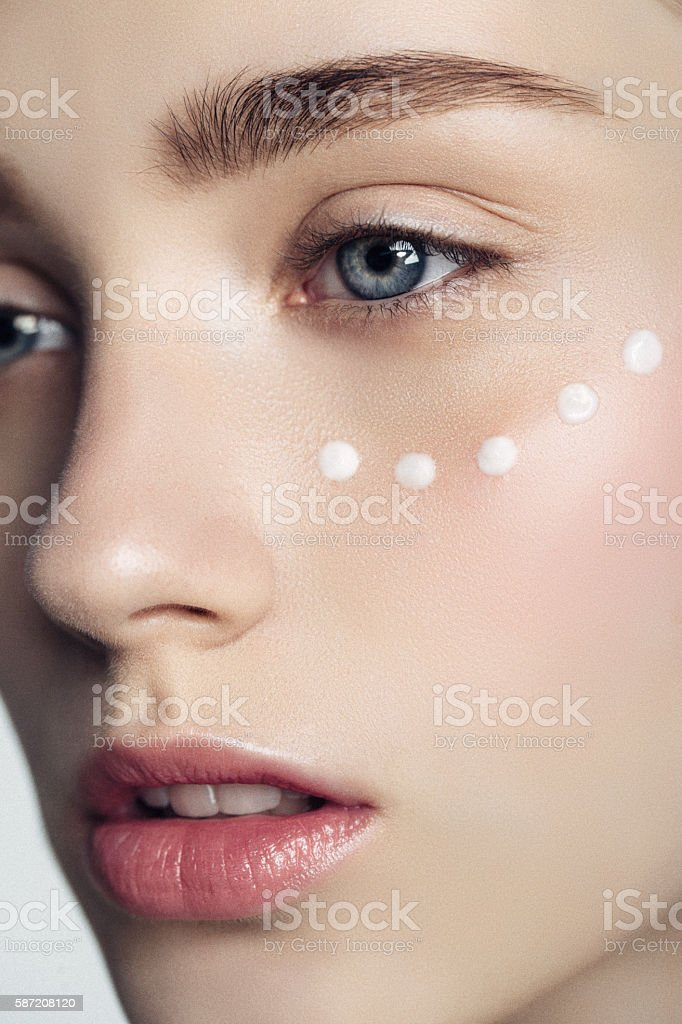 Beautiful woman with cream dots on the face stock photo