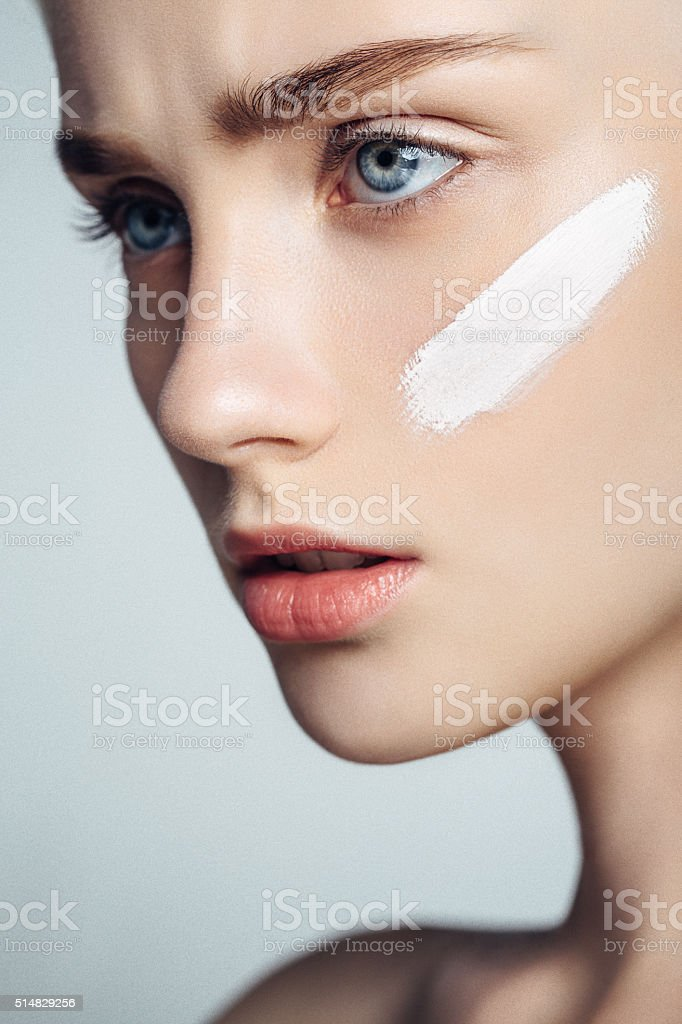 Beautiful woman with cream stock photo