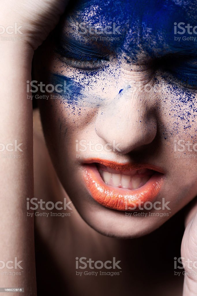 Beautiful woman with creative make-up. she is full of emotion. royalty-free stock photo