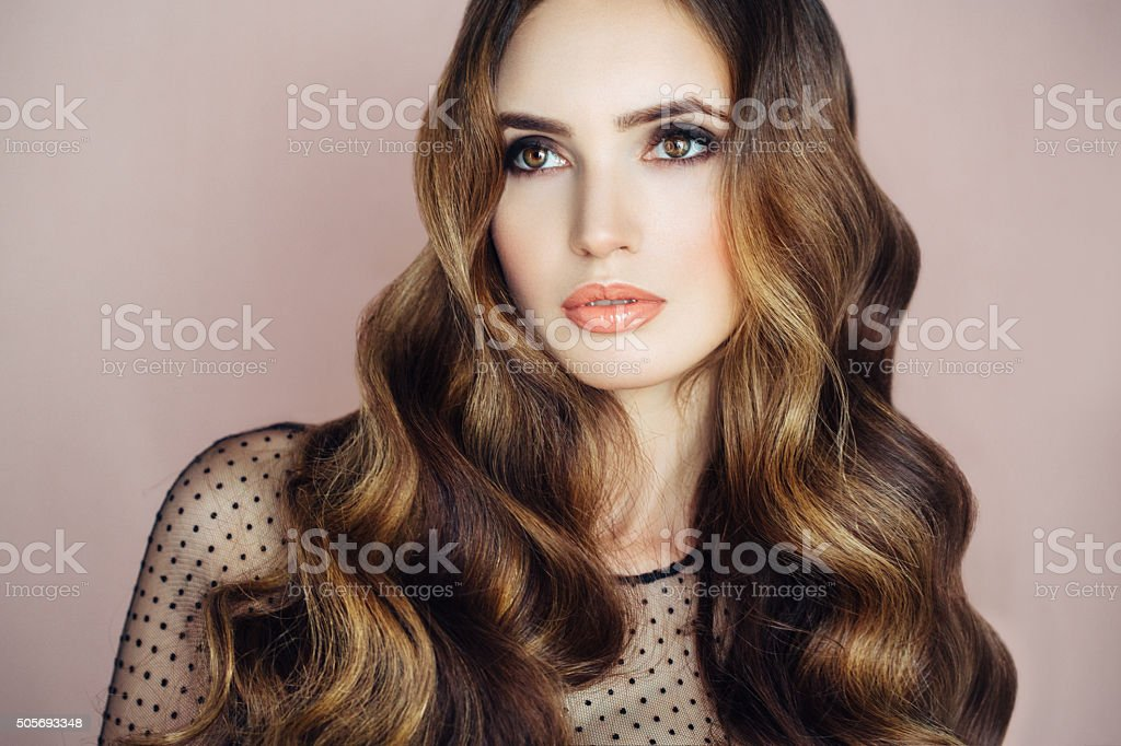 Beautiful woman with curls stock photo