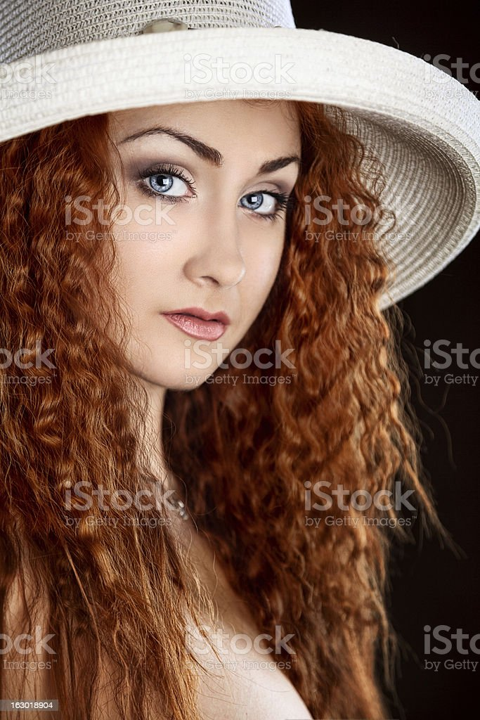 Beautiful woman with curly red  hair royalty-free stock photo
