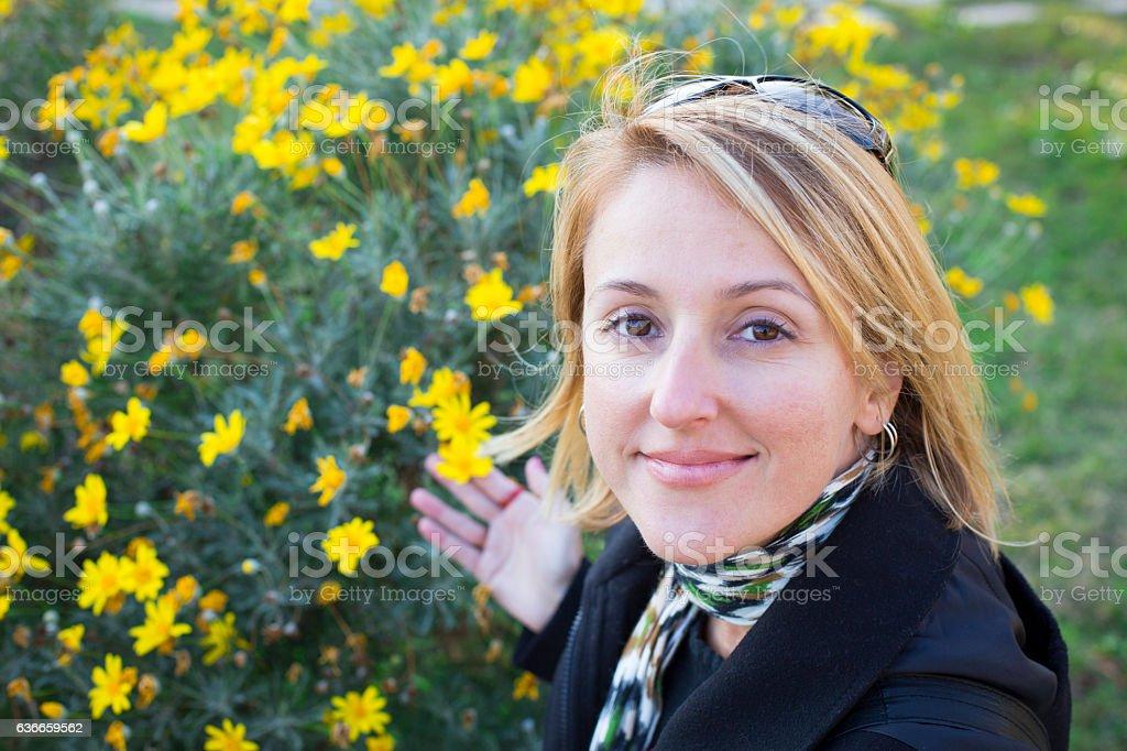 Beautiful woman with daisy stock photo