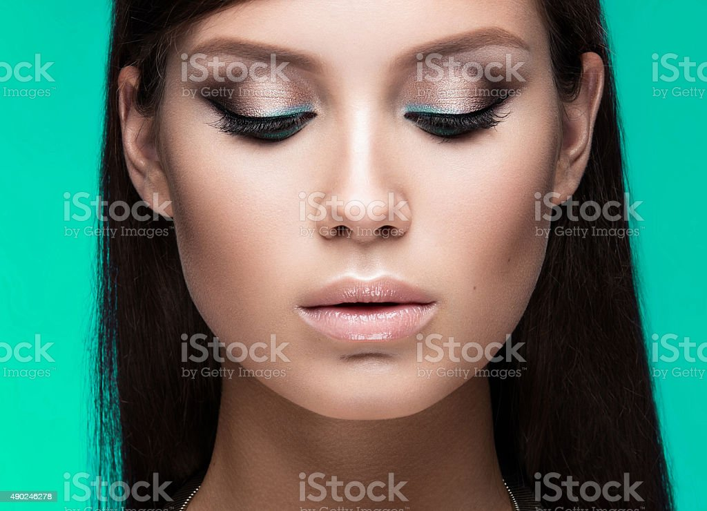 Beautiful woman with evening make-up and long straight hair stock photo