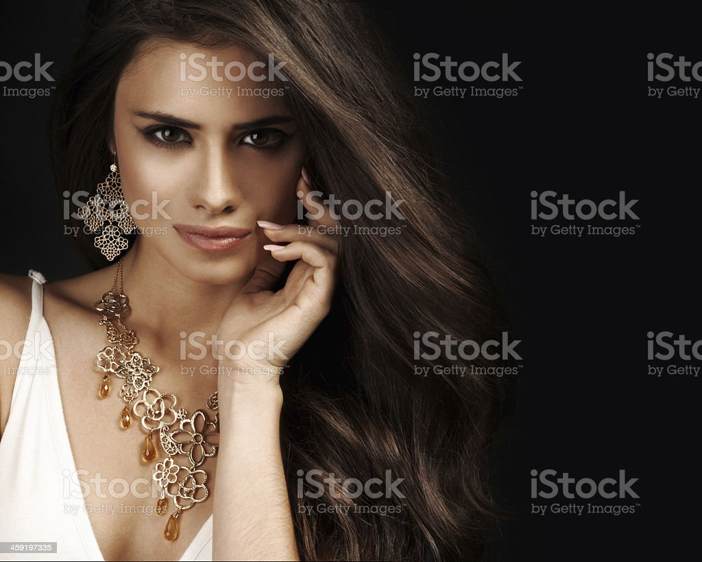 Beautiful woman with evening make-up. Jewelry and Beauty. Fashion photo stock photo