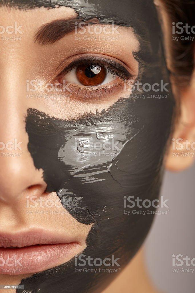 Beautiful woman with facial mask. stock photo