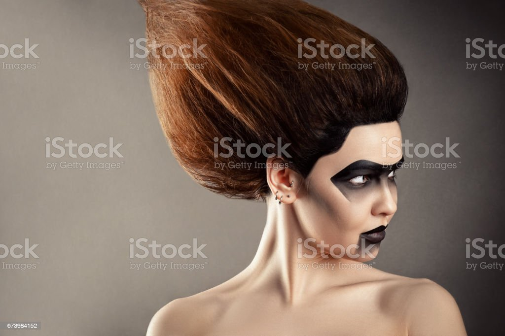 beautiful woman with fashion hairstyle and creative makeup stock photo