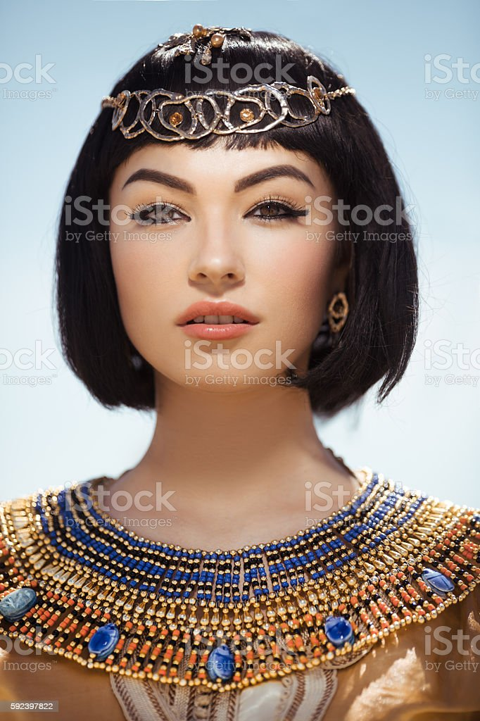 Beautiful woman with fashion make-up and hairstyle like Egyptian stock photo