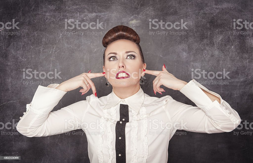 Beautiful woman with fingers in her ears stock photo