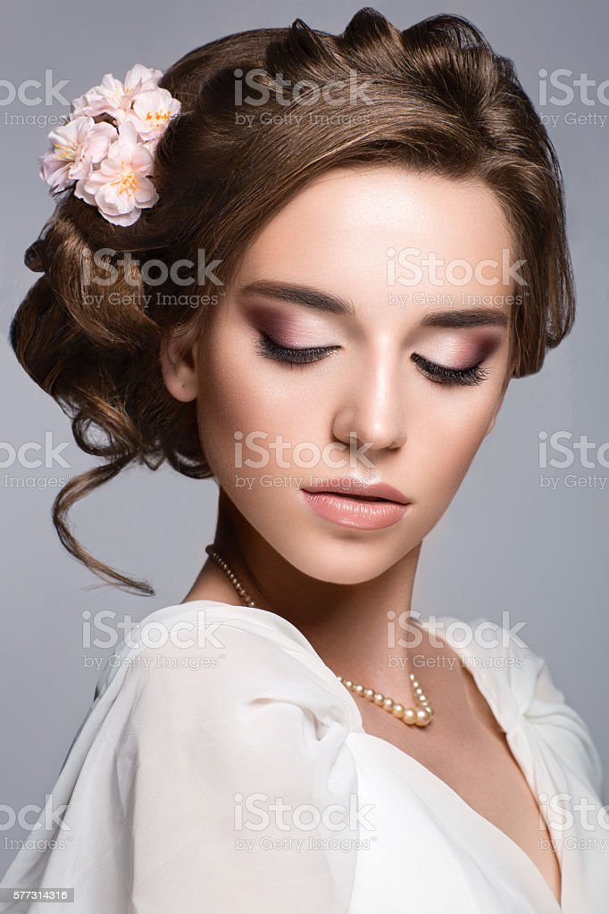 Beautiful woman with flower. Bride stock photo
