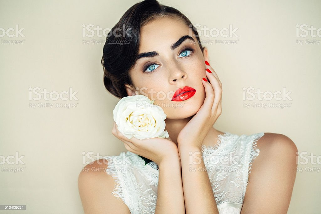 Beautiful woman with flower stock photo