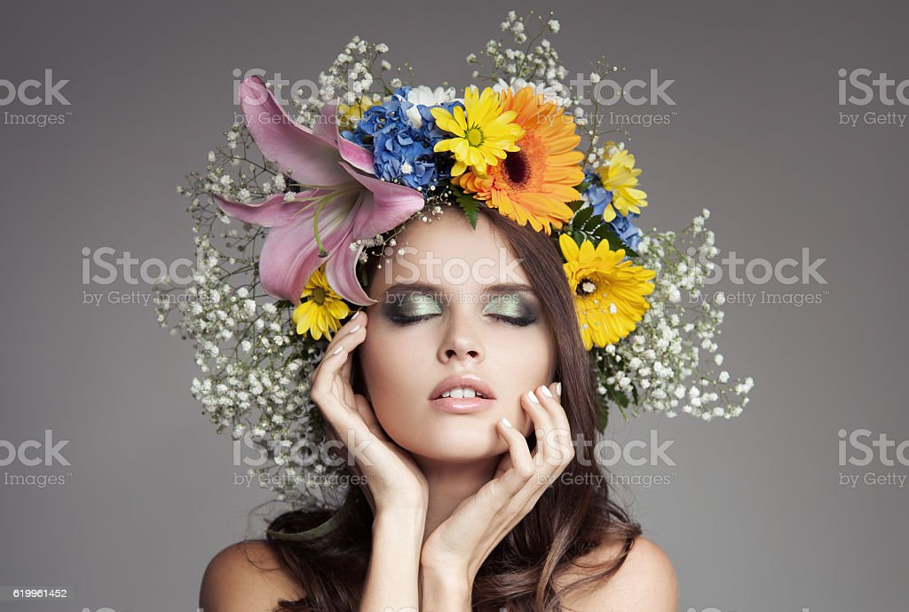 Beautiful Woman With Flower Wreath On Her Head. stock photo