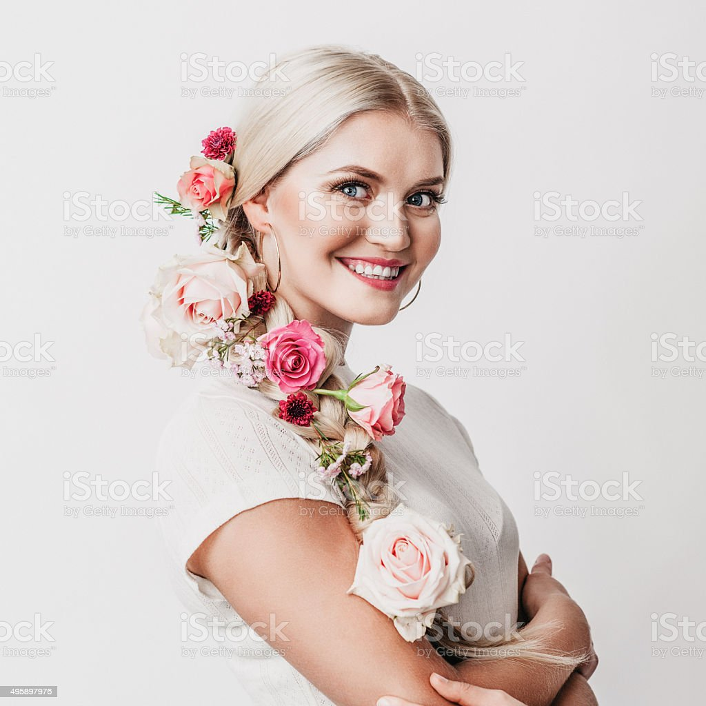 Beautiful woman with flowers in her hair stock photo 495897976 beautiful woman with flowers in her hair royalty free stock photo dhlflorist Gallery