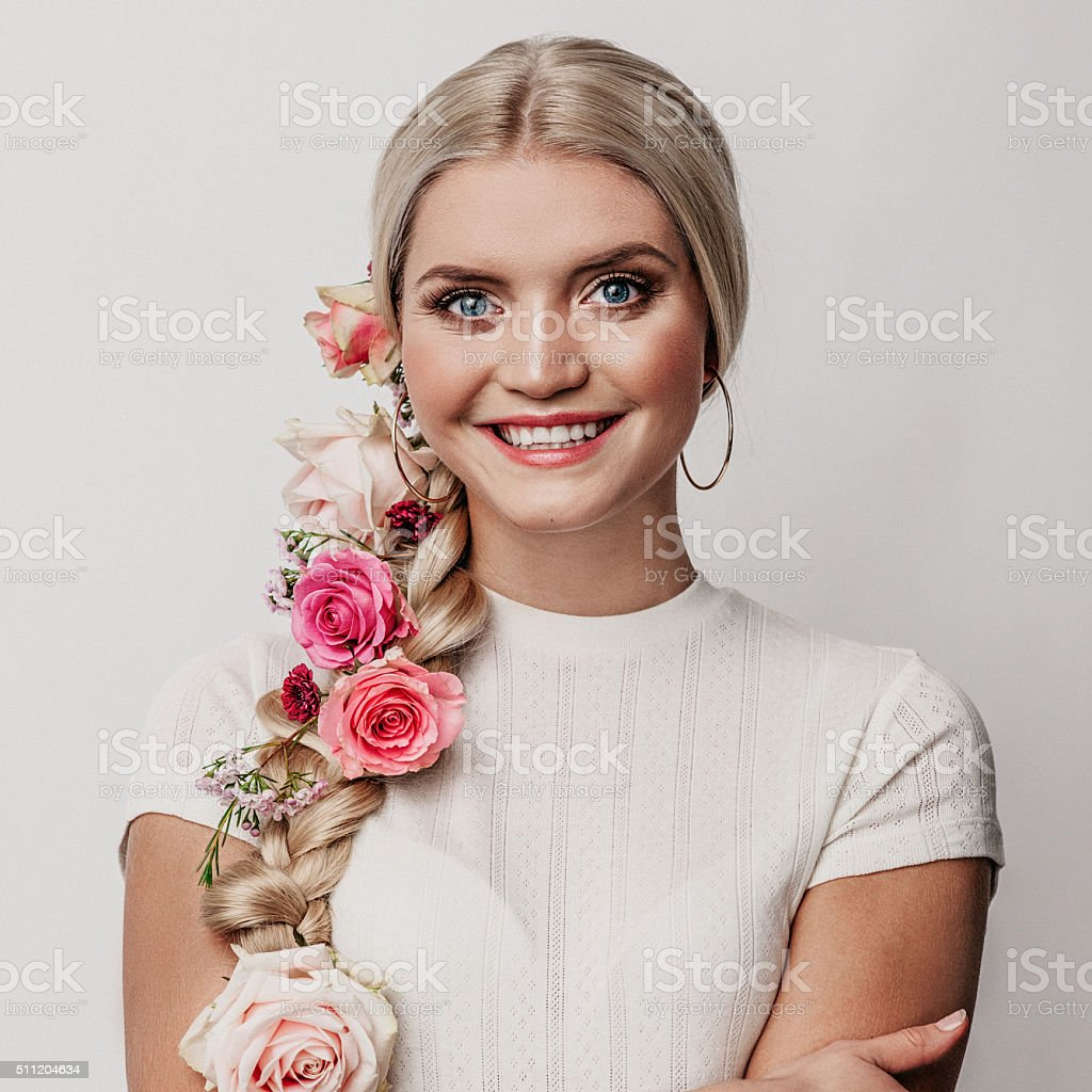 Beautiful woman with flowers in her hair stock photo 511204634 beautiful woman with flowers in her hair royalty free stock photo dhlflorist Gallery