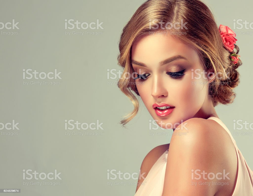 Beautiful woman with flowers in the hair stock photo 624529674 beautiful woman with flowers in the hair royalty free stock photo dhlflorist Gallery