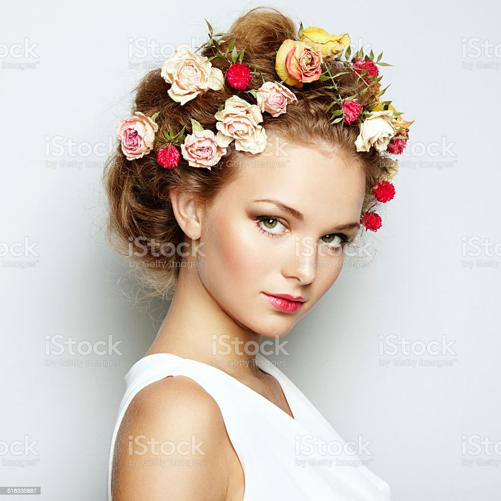 Beautiful woman with flowers. Perfect face skin. Beauty Portrait stock photo