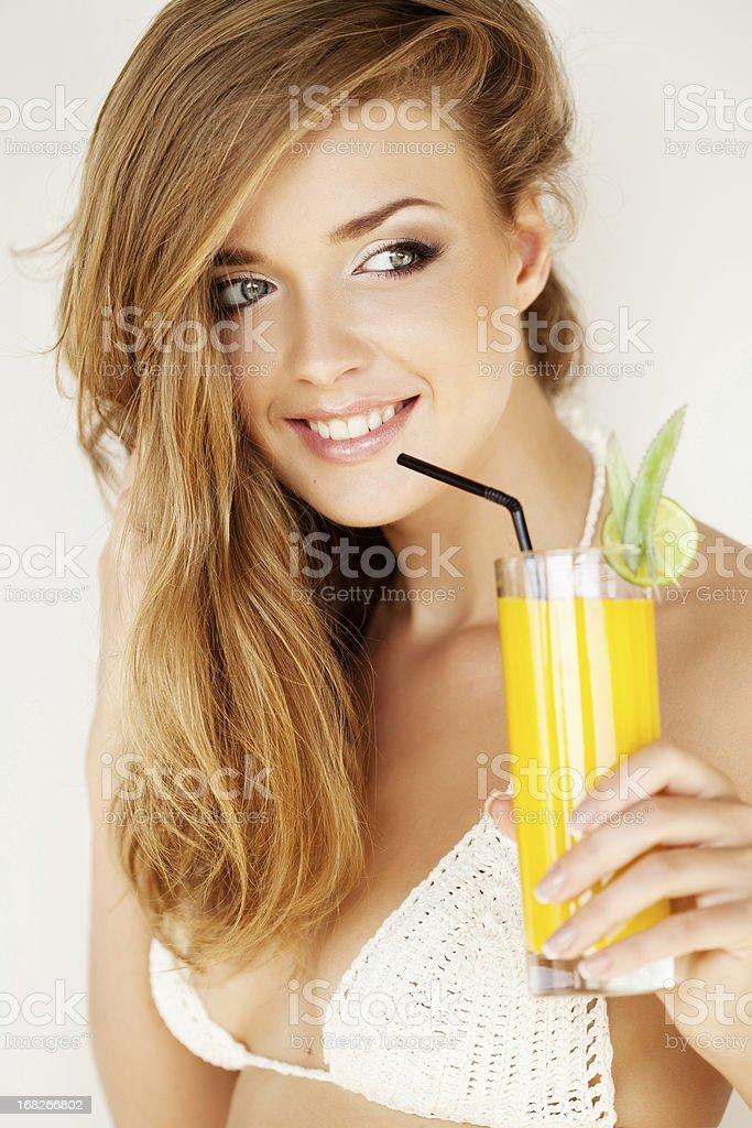 Beautiful woman with fresh juice royalty-free stock photo