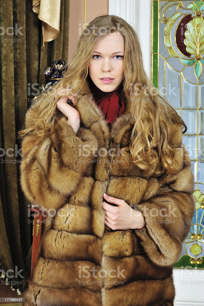 beautiful woman with furs in the  luxurious classical interior stock photo