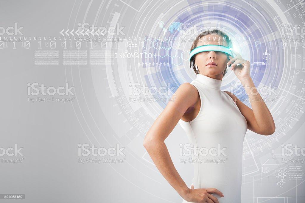 Beautiful woman with futuristic glasses stock photo